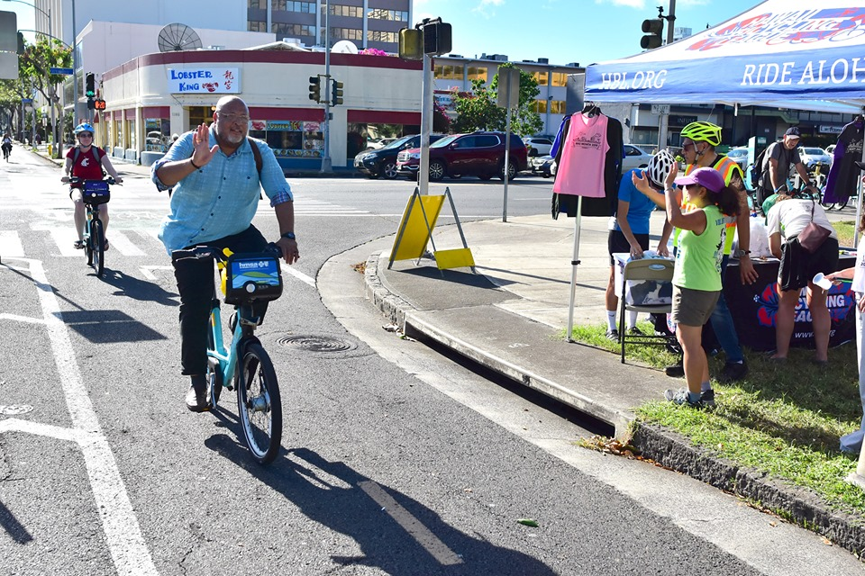 Rider Crossing Keaaumoku Street on the S King Protected Bike Path