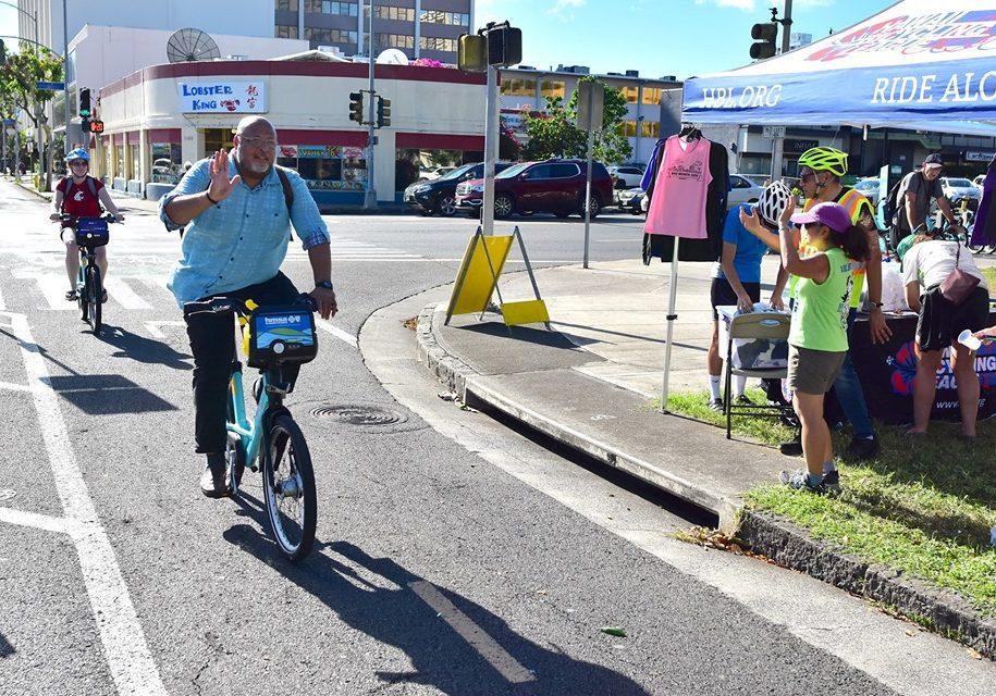 Rider Crossing Keaaumoku Street on the S King Protected Bike Path